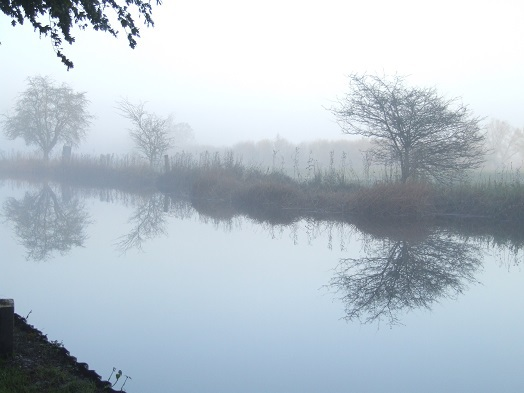Canal reflections in the mist