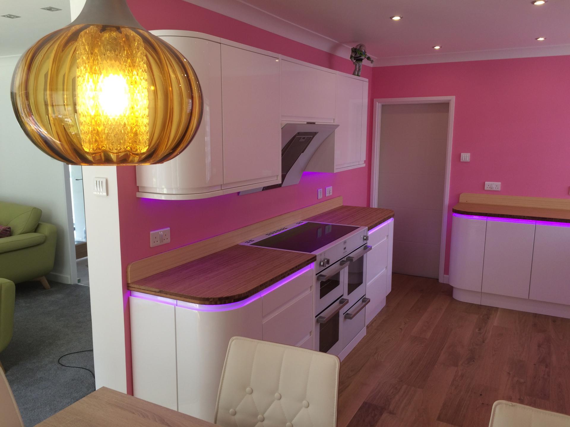 Curvy pink kitchen & retro 60's lights