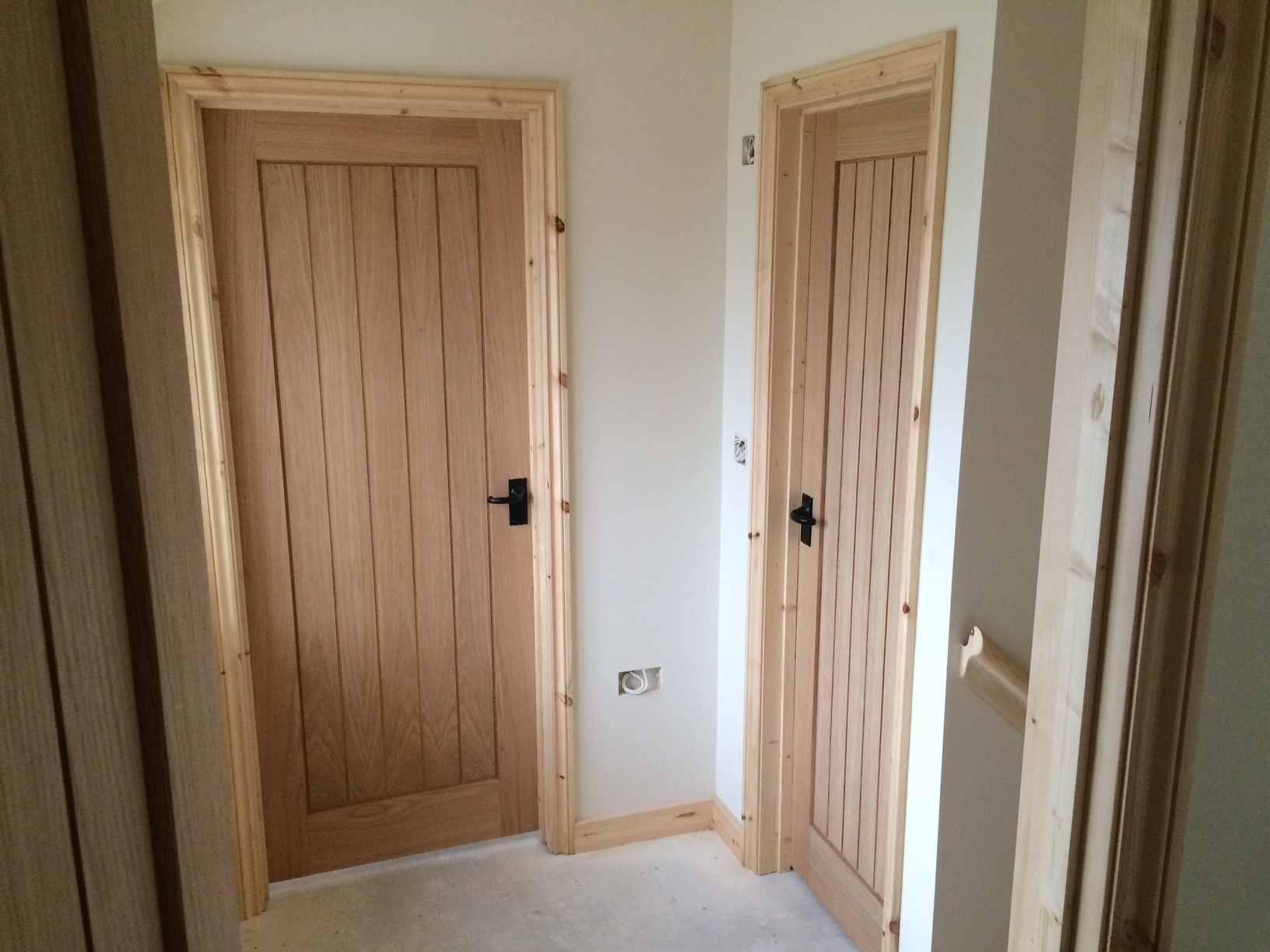 Oak Doors with Traditional Black Iron Hardware