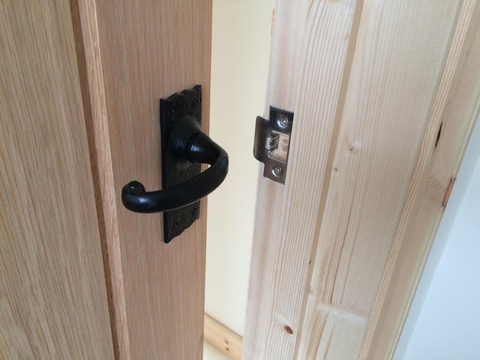 Black Iron Door Handle on Oak Door