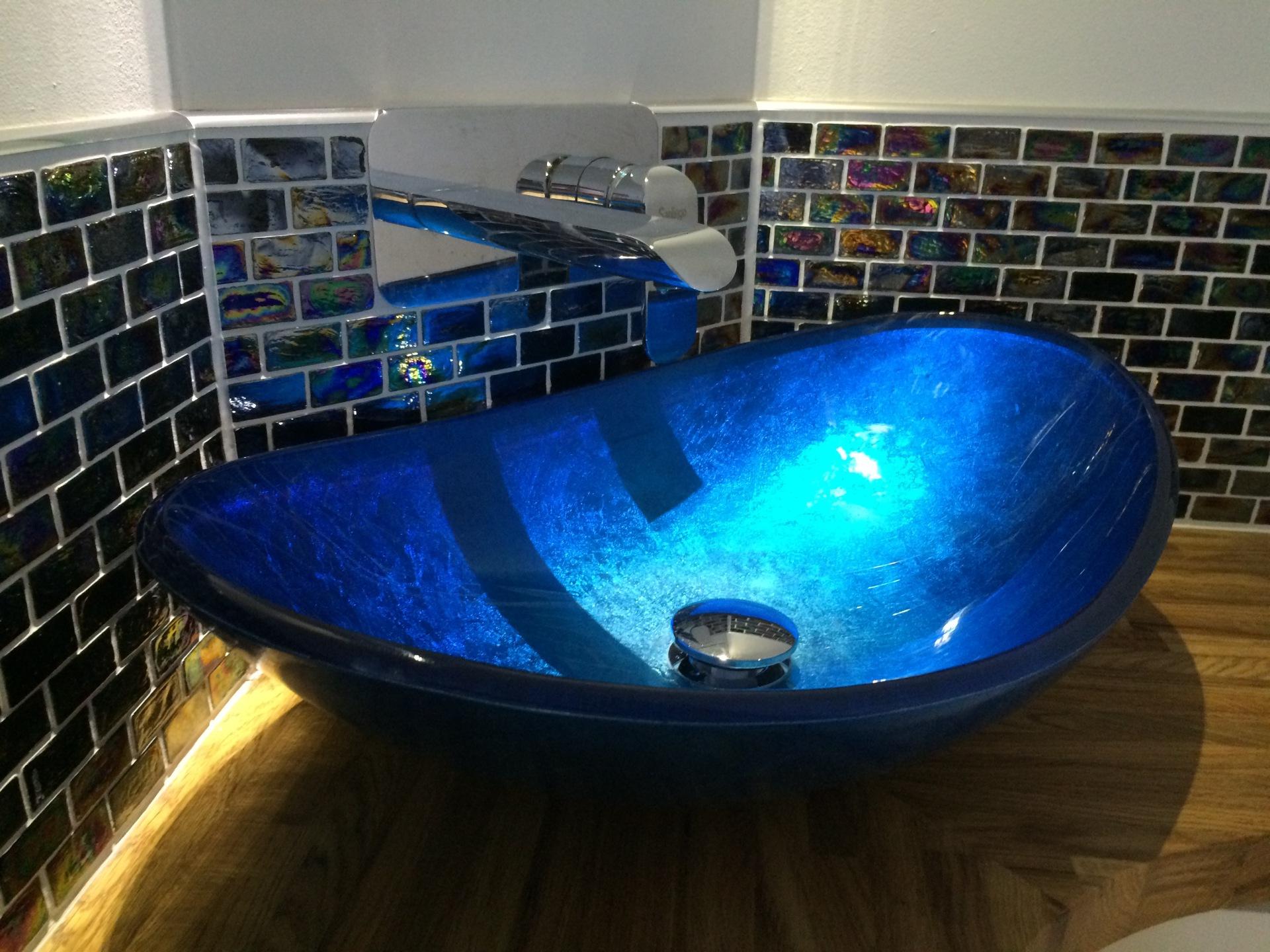Solid glass blue bathroom basin.