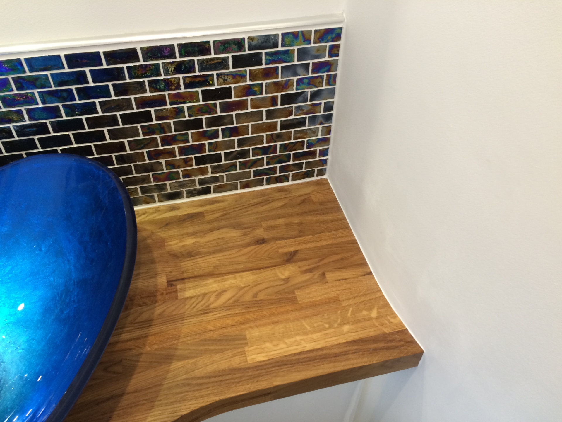 Glass bathroom sink with glass mosaic tiles