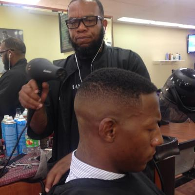 CHAMP THE BARBER