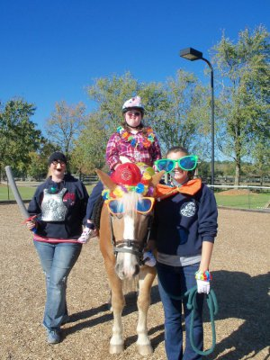 Volunteers in a Therapeutic Riding lesson at Rocking Horse Ranch