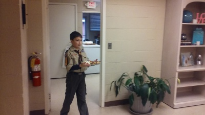 Alex from the Cub Scouts Helping at The Hudson House.