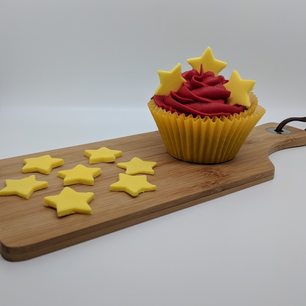 Speciality Cupcakes, topped with fondant stars