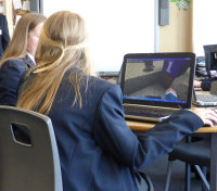 Girls playing MinecraftEDU