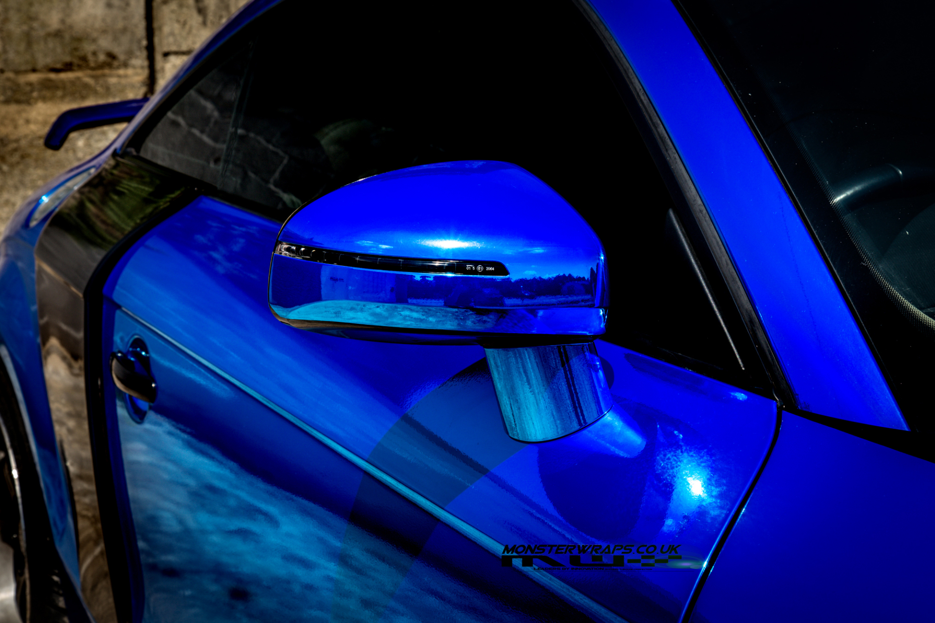 Audi TT mk2 wrapped in blue chrome with gloss black details