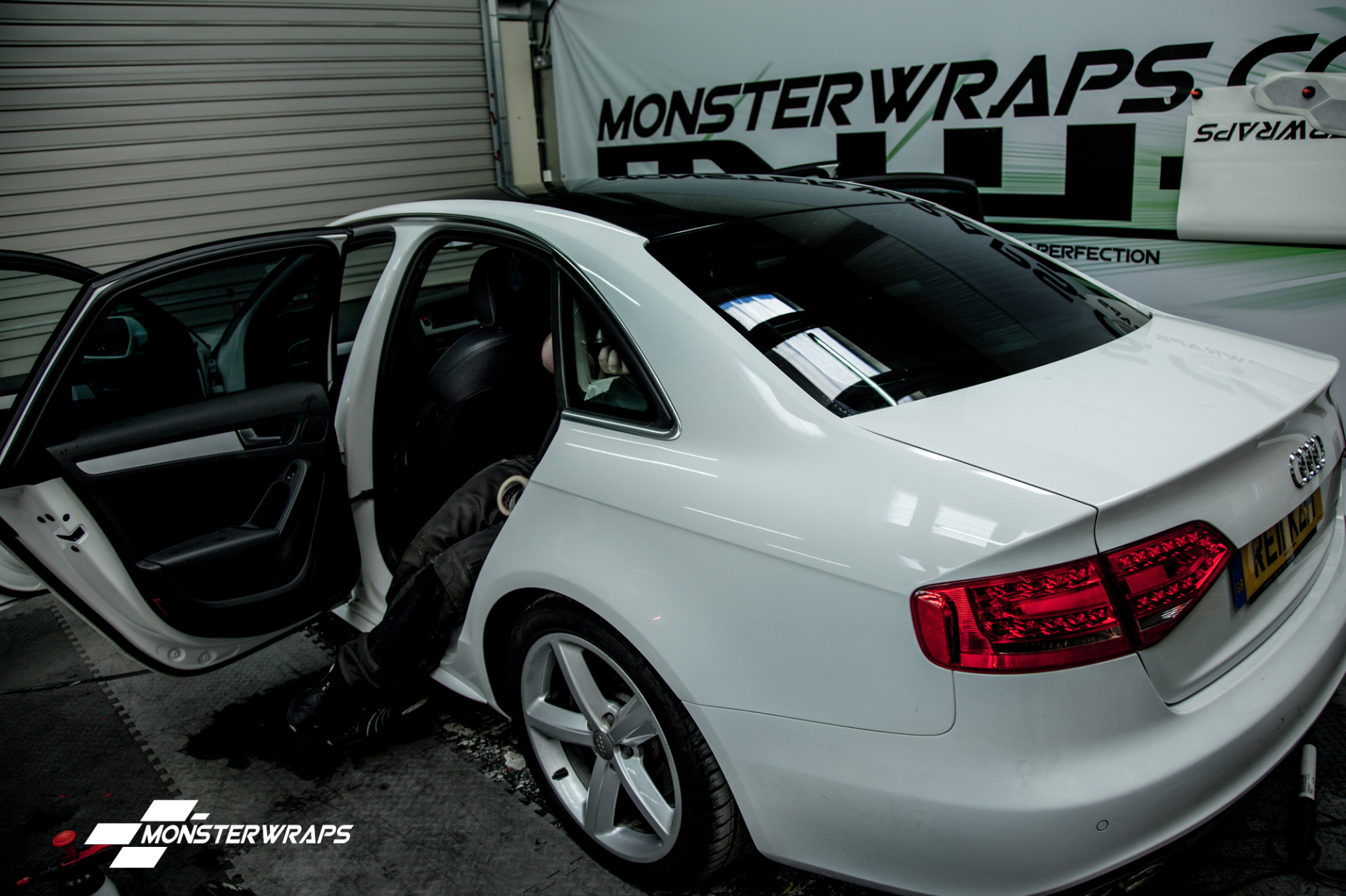 Audi A4 gloss black roof wrap and window tints