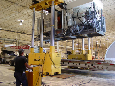 Loading a 2,000-ton Molding Machine.