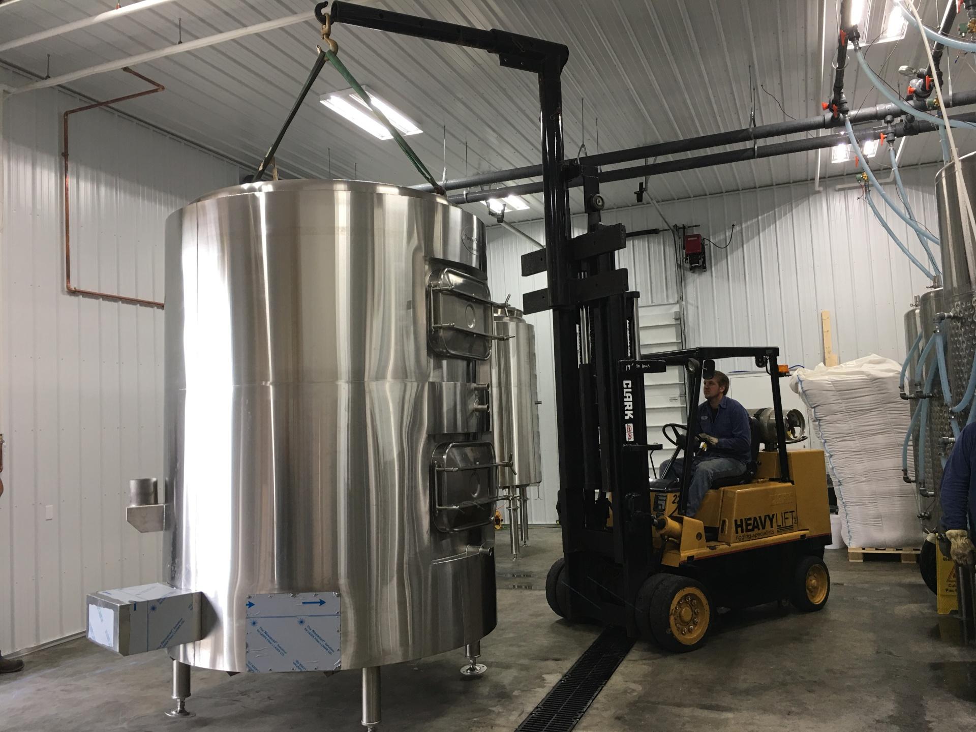 Installing two 15 BBL HLT/Mash Tanks for Elk Brewing.
