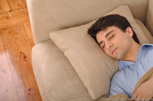 man napping on couch