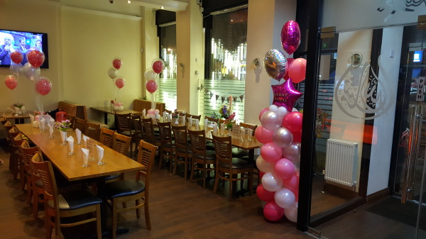 Happy birthday!! Pink white and silver balloon decorations!!!