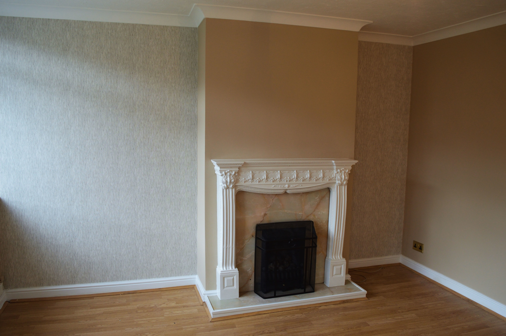 decorated living room with wallpaper feature wall