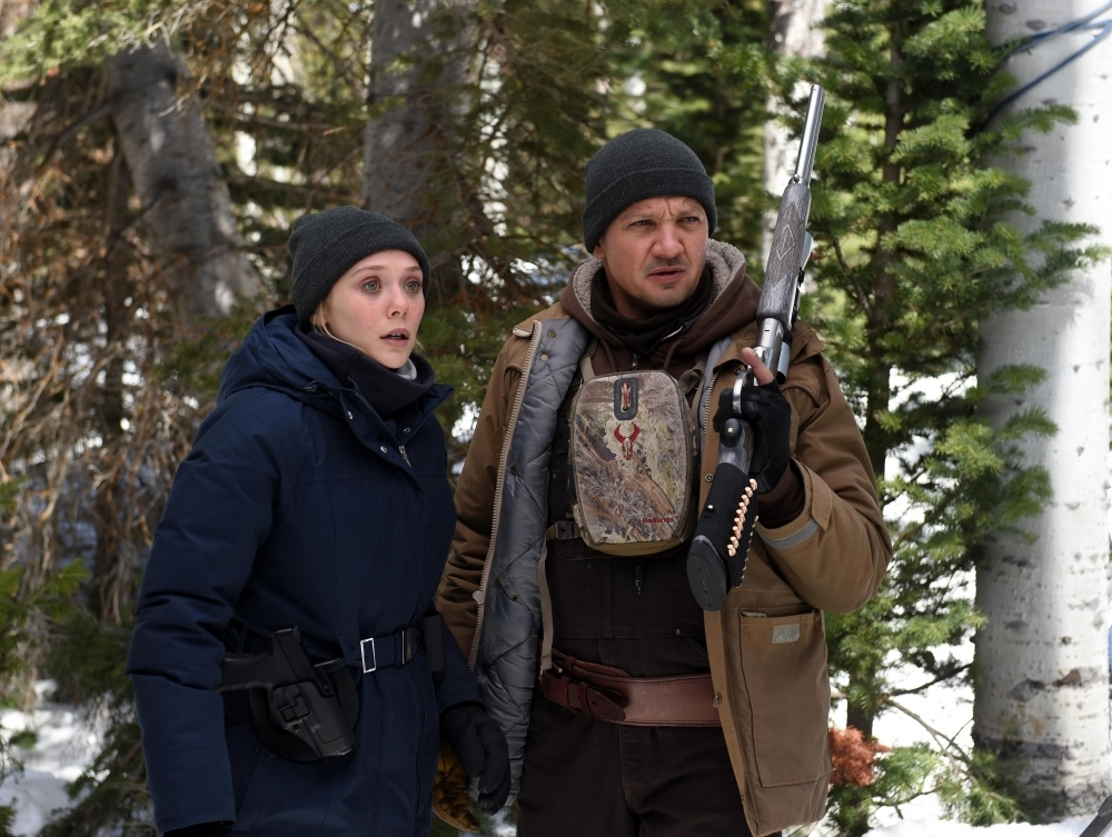 "Jeremy Renner and Elizabeth Olsen Track a Killer in the Chilling Trailer for ""Wind River"""