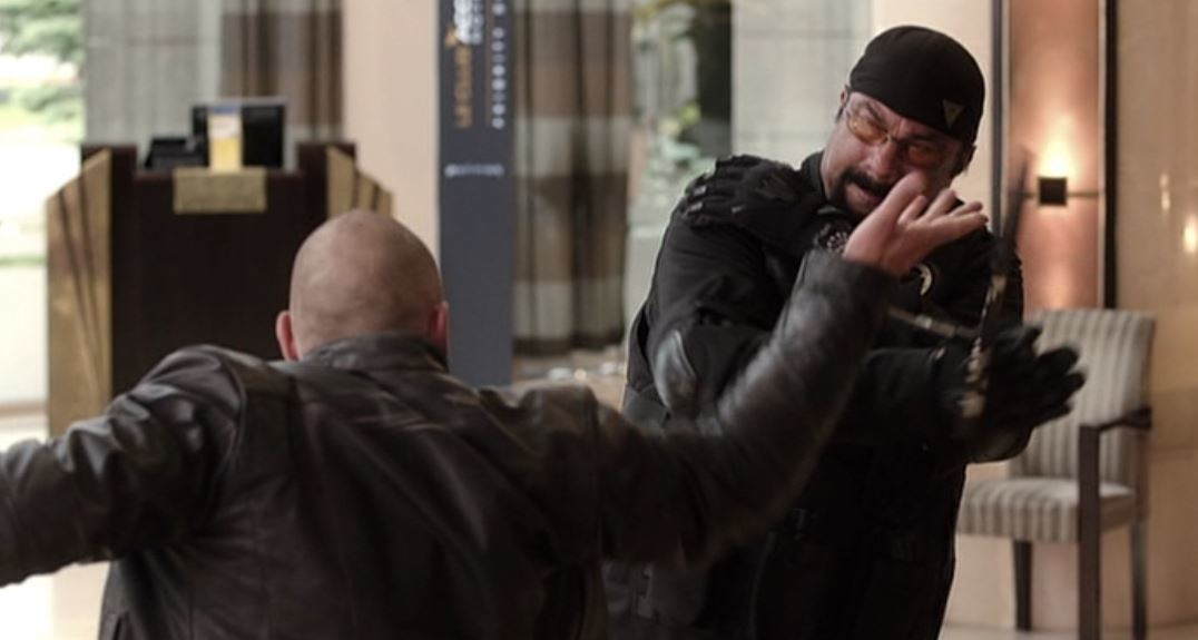 "Review: Steven Seagal and Luke Goss Bring the Pain in the Action-Thriller ""Cartels"""