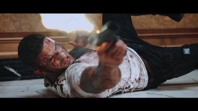 OUTLAWED: Adam Collins is the Real Deal in the High-Octane Trailer for the New Action Flick!
