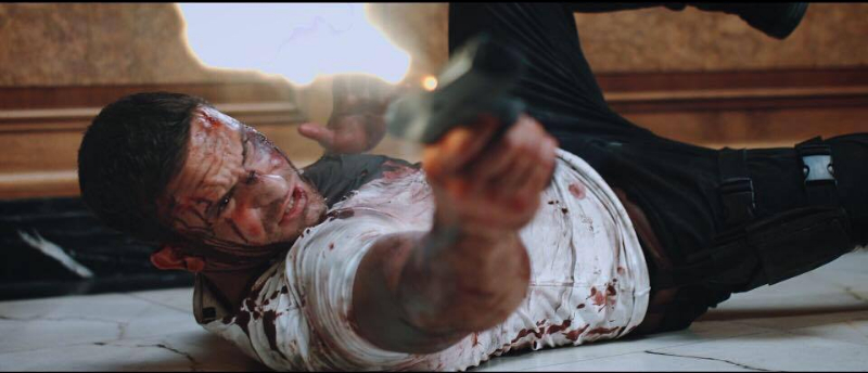 REVIEW: OUTLAWED is the Perfect Action Throwback and Ushers in a New Action Hero in Adam Collins