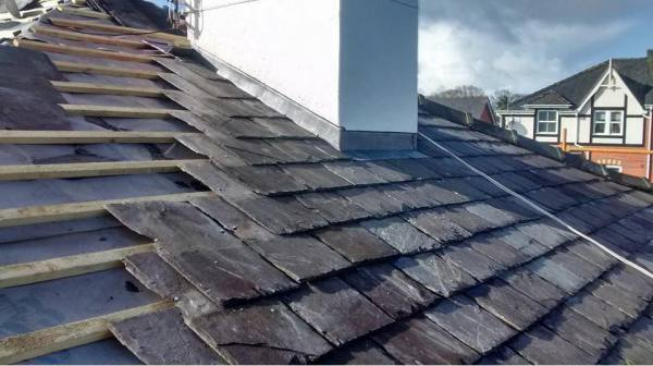 re slated roof in southport with new cockney style lead flashings on chimney stack