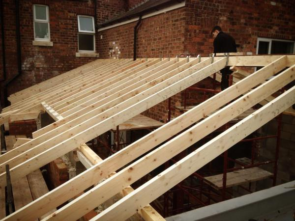 new hand cut roof on large double extension we built ready for the roofers