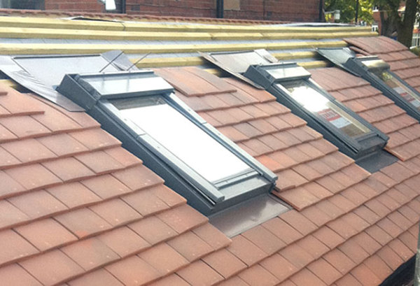 new velux sky lights on new roof tiles with new marley rosmary tiles in ormskirk
