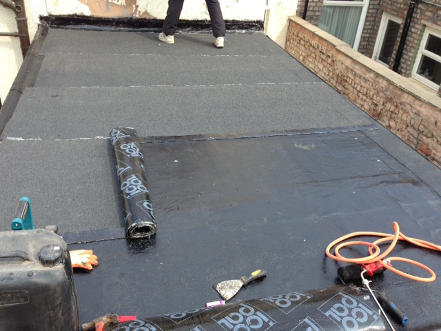 three layer bitumen sbs torch on felt flat roof repairing a failed leaking flat roof