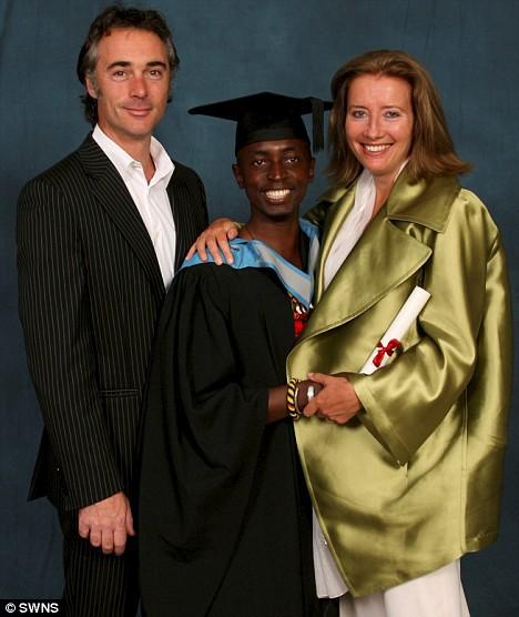 Proud African adoptee graduates.