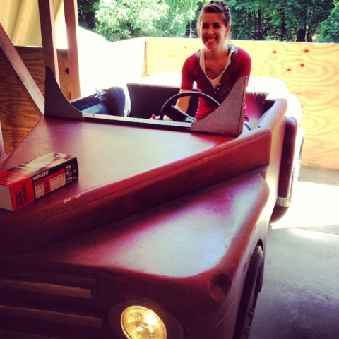 Liz testing out the Grease car