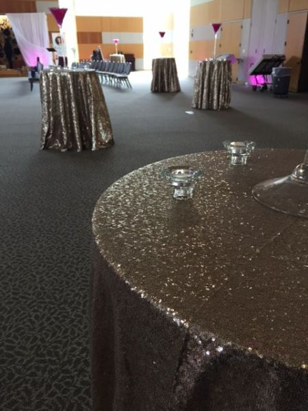 Champagne sequin linen on cocktail tables