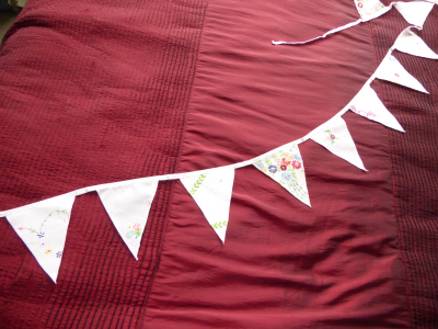Beautiful and unusual bunting made from vintage tablecloths.