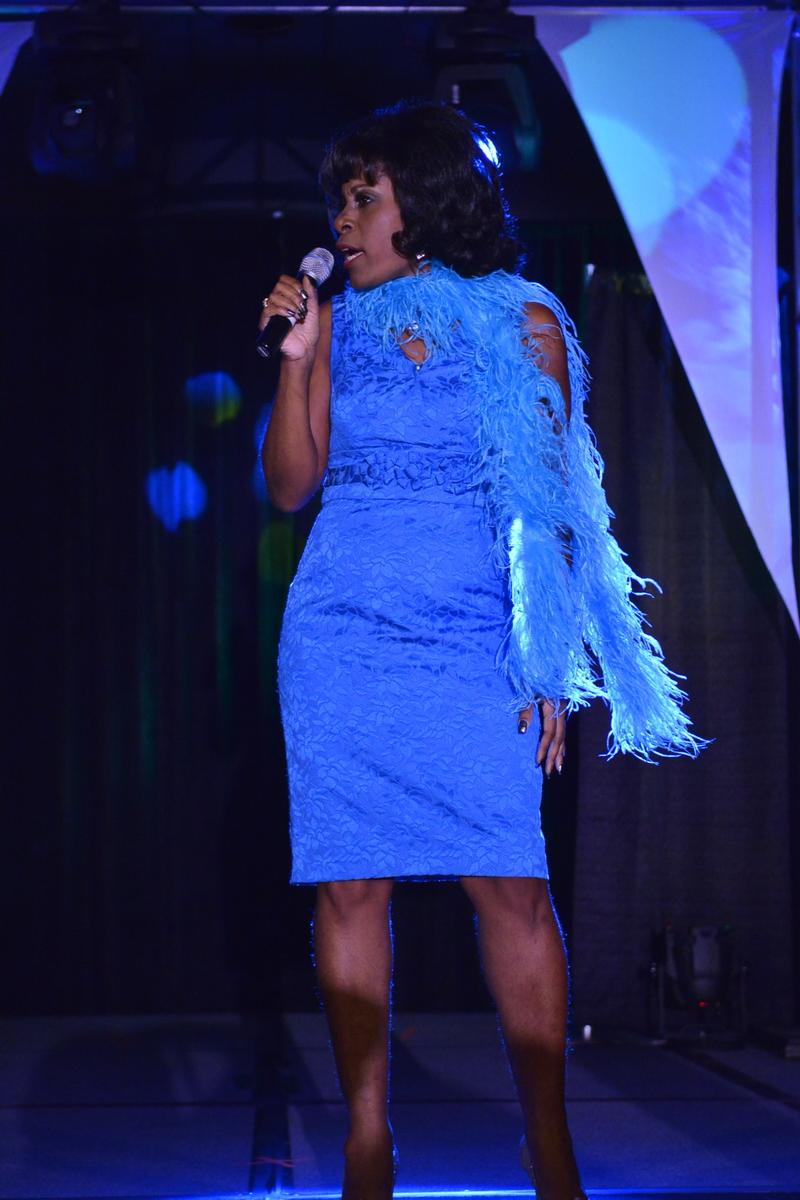 Carlene as Aretha