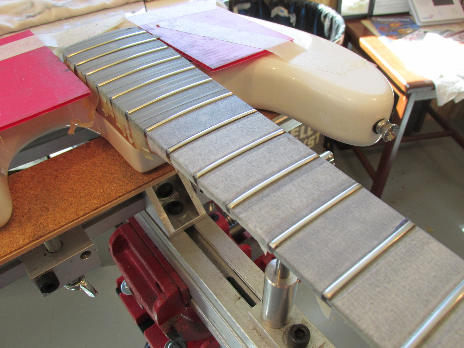 Fret leveling activity on a custom Jazz Bass