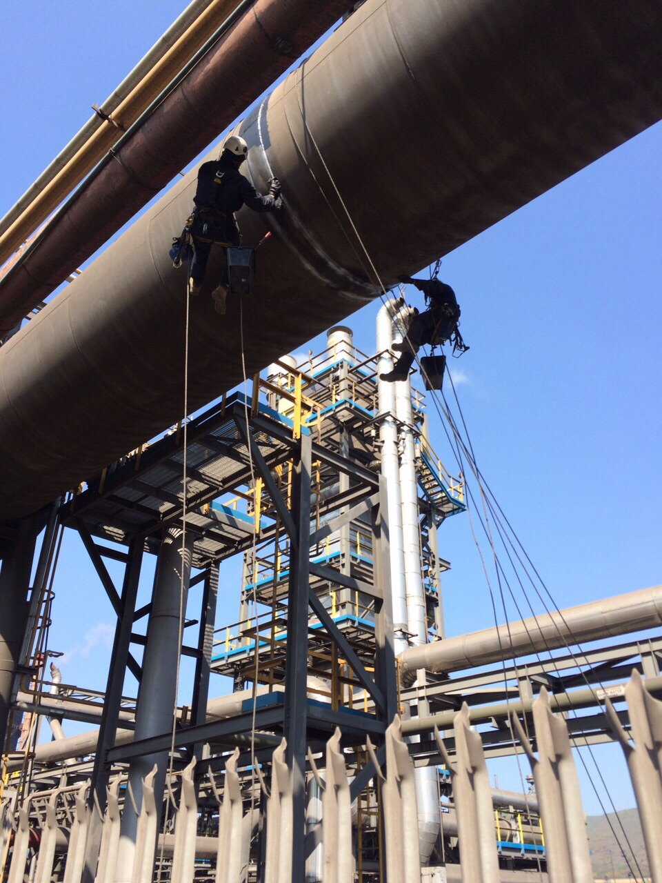 <Industrial rope access and NDT inspection of pipeline re-applying paint coating >