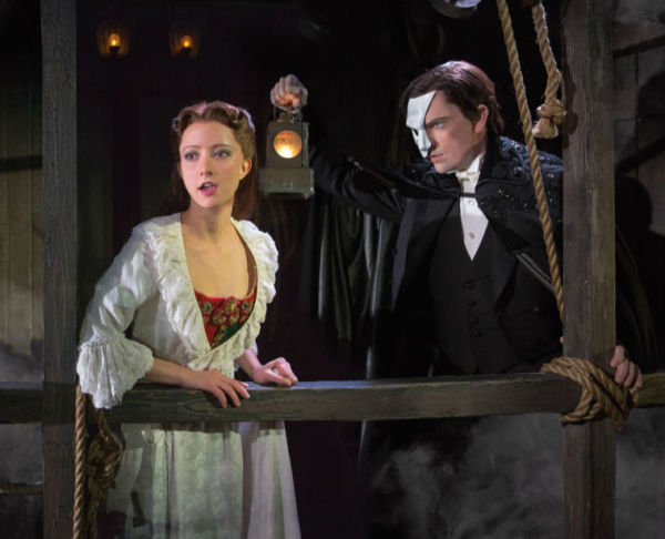 Christine (Katie Travis) and the Phantom (Chris Mann) behind the mirror Photo Credit: Matthew Murphy
