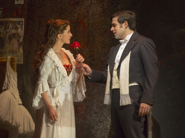 A red rose for Christine (Katie Travis) from Raoul (Storm Lineberger) Photo Credit: Matthew Murphy