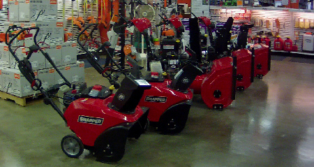 Snow blowers on showroom floor