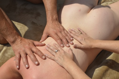 Four handed tantric massage