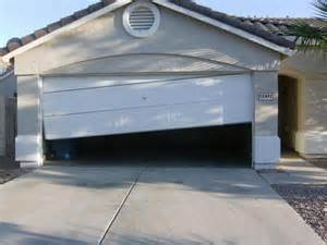 Door off tracks? Let a professional fix it to prevent further damages!