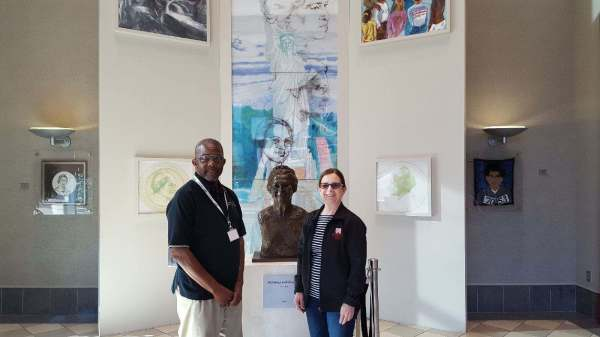 Guide Jake Williams accompanying guest S. Bean from Wisconsin at the Rosa Parks Museum