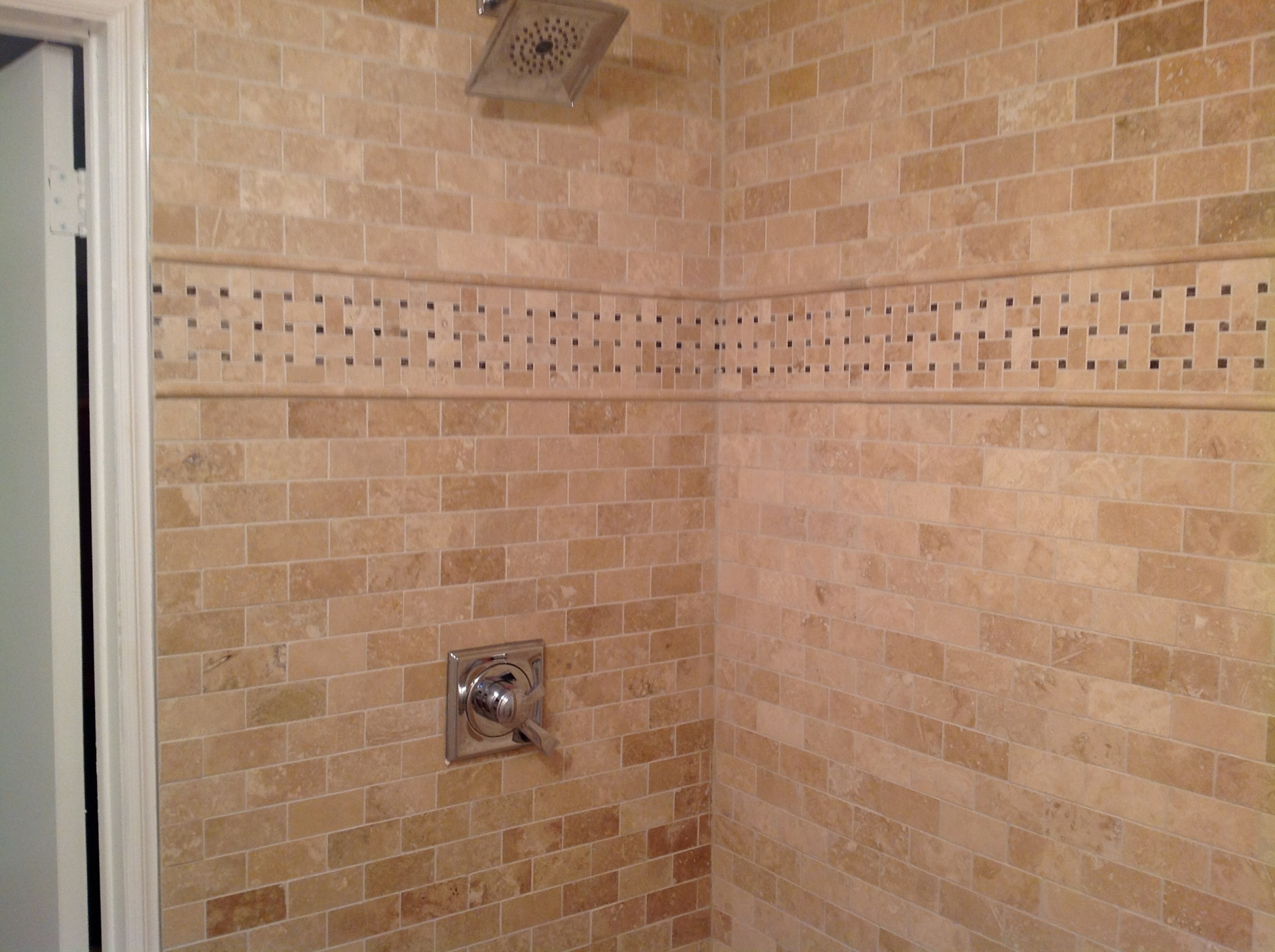 Shower tiled in travertine