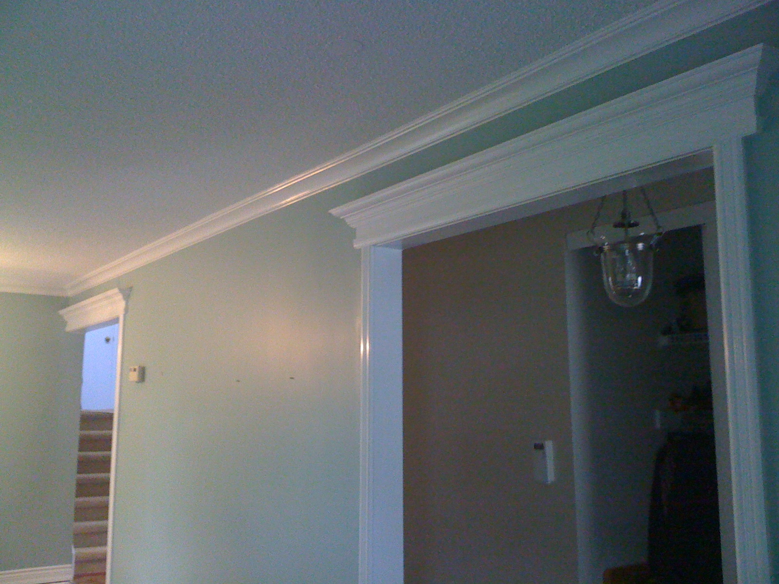 Living/Dining room with crown molding and Mantels