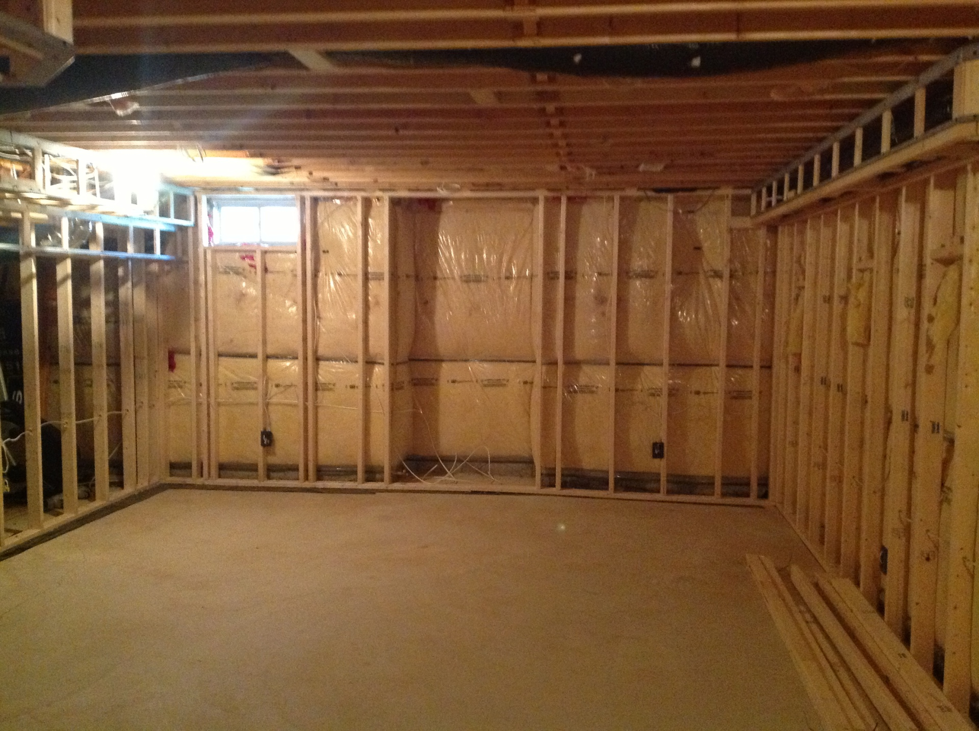 Basement framed for living area with fireplace