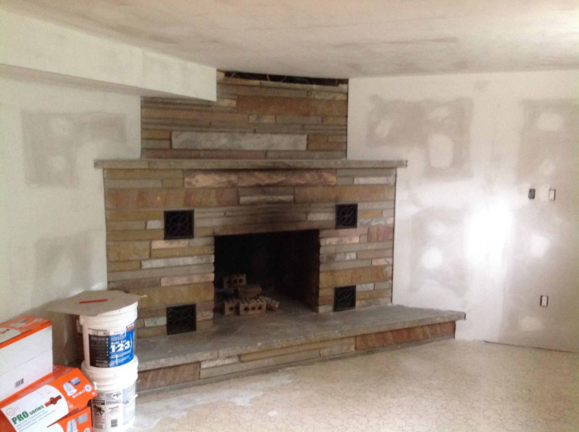 Drywall around brick fireplace