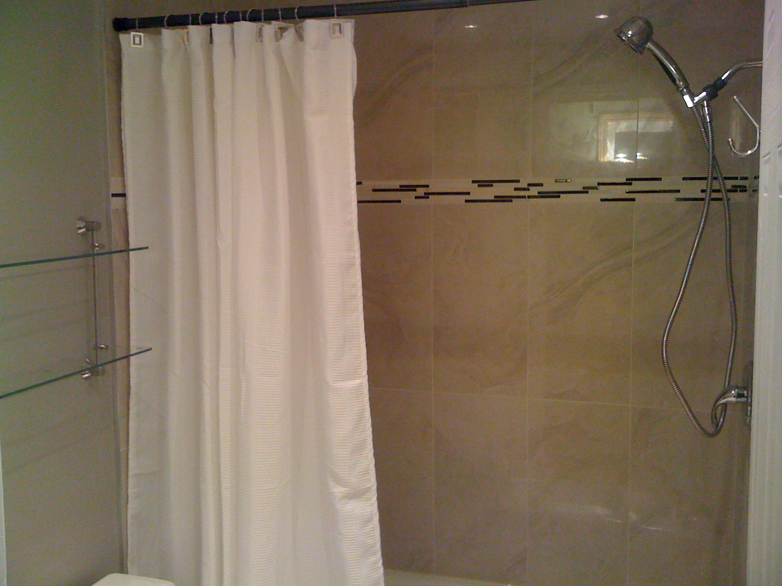 Bathtub Shower tiled with marble