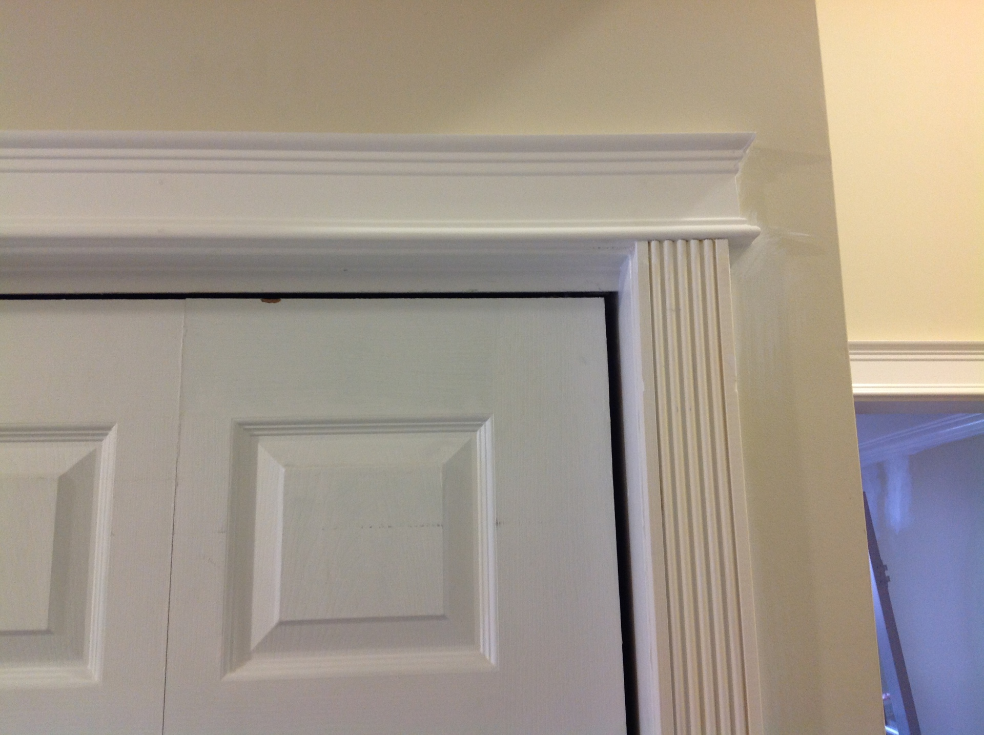 Mantel work over bi-fold door