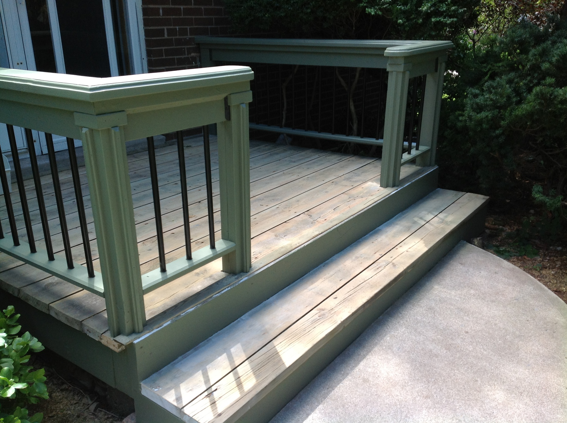 Restored deck with painted handrail and metal spindles