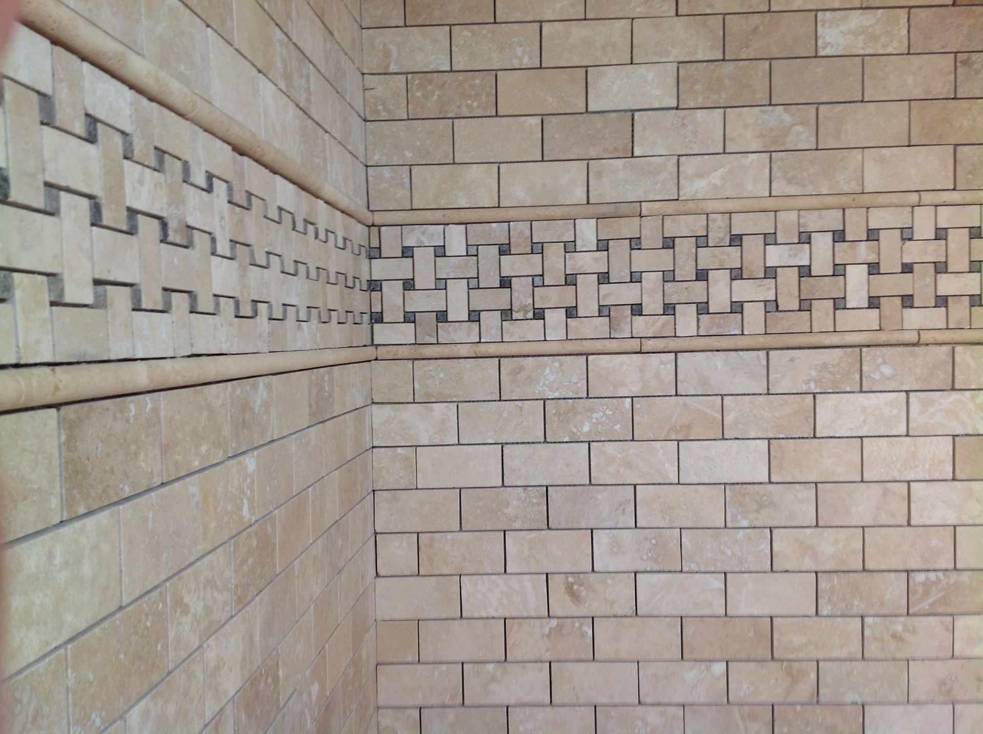 Marble boarder with mosaic tiles.
