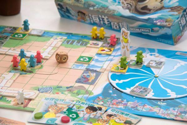 Overcome a tsunami of trash in Ocean's Crisis; a co-operative family-friendly board game.