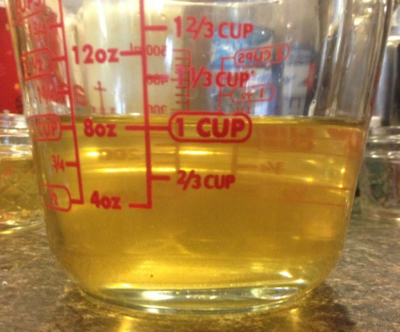 Strained bear oil in a measuring cup.