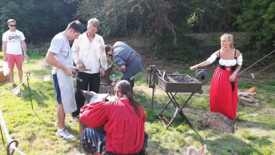 During one of the workshops, with the local master armoursmith repairing some armour.